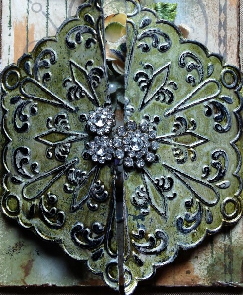 Embossed metal tape with patina and bling