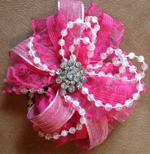 Created from ribbon, lace, string pearls